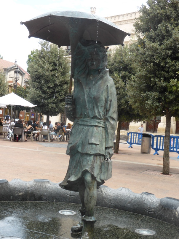 Hard to see, one of so many fanciful statues about town - this one a fountain with water falling  off the umbrella