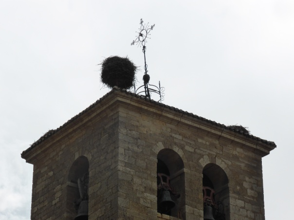 That's a stork's nest on the top of our  destination church.  Look at the size!