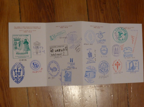 Those are our Camino passports. Every day we would find some special place that would certify our passing.  Next year that passport, when completed, will allow us to be awarded the a compostela, a certificate of completion of the pilgrimage.