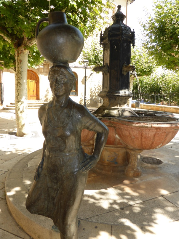 A statue in the town square - that's a wine container on the bronzed statue