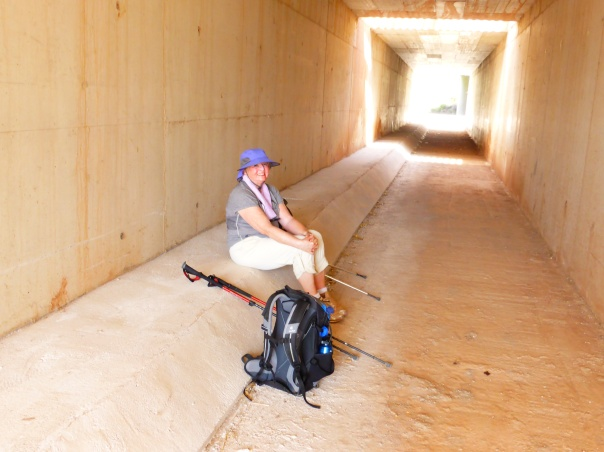 That's not Mutti waiting for a bus... During our cross country jaunt we needed some rest and shade. We found cool protection in a water culvert tunnel.