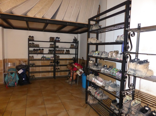 "An  Auberge ( a hostel) here in Spain an Albergue - very basic communal accommodations costing from 5 to 10 Euros a night ($7 - $14) used by the majority of pilgrims. I snuck into the one here - this picture is the ""boot room"""