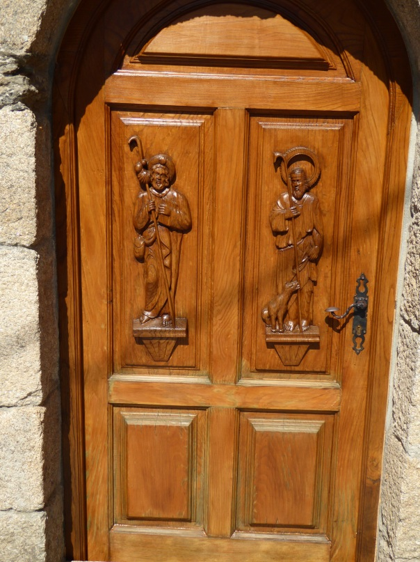 Beautifully carved doors, a common sight.  Between the handsome doors and the always present flower box display, even the time washed apartment can be so welcoming.