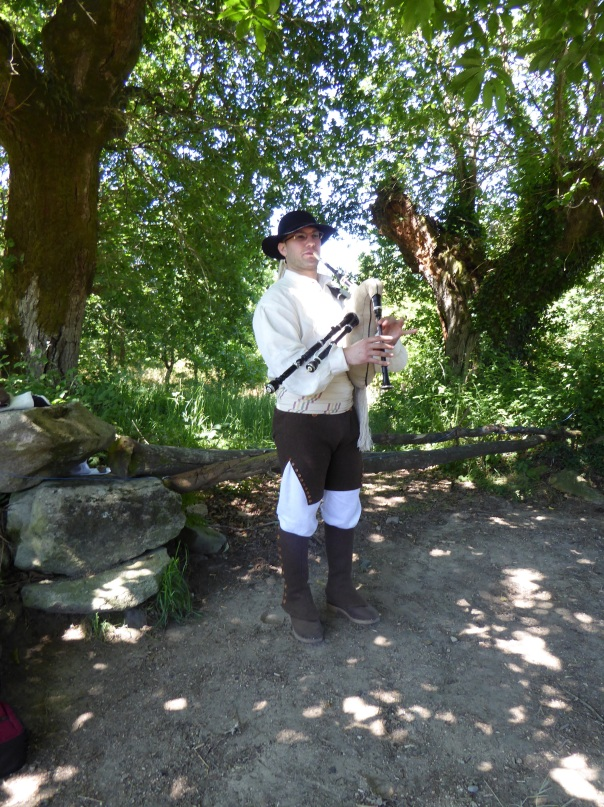 A Galician piper, playing the Gaita Gallega - a Galician bagpipe.