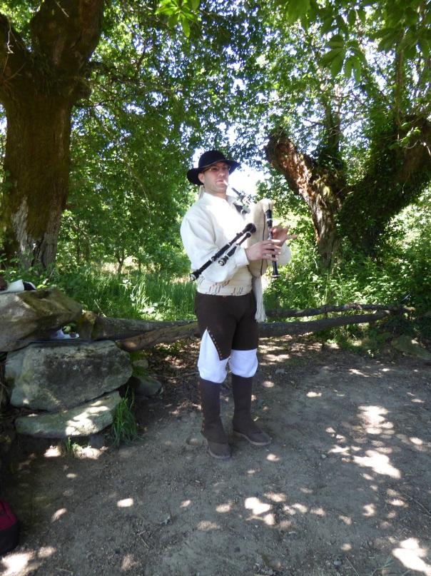 A Galician piper, playing the Gaita Gallega - a Galician bagpipe.