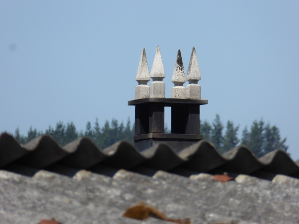 The symbols places on the top of chimneys to ward off evil spirits.