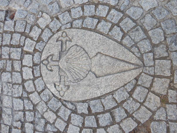 The Camino trail is marked in many ways, the most usual being the shell in either metal or plaster / cement or simply a yellow arrow to indicate the way. Here the Templar influence incorporating the shell with the sword.