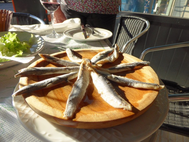 Hmmmm... On the menu it said anchovies.  Those are the biggest anchovies I have ever seen and that's not olive oil, it's vinegar!