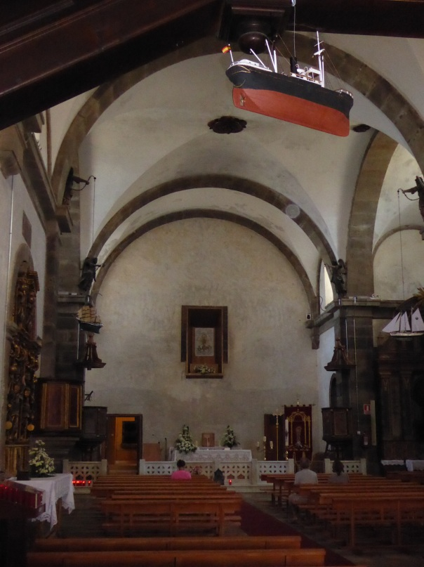 The chapel at Finisterre. Note the fishing boat suspended from the ceiling.