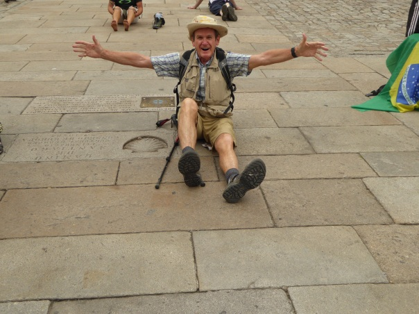 The next series of pictures, hopefully in the order I want them to be! Tell the story of the joy and agony at the finish.  Yes, some who completed the Camino were excited.  Here I am at the Camino shell symbol in the very middle of the square in front of the Cathedral.