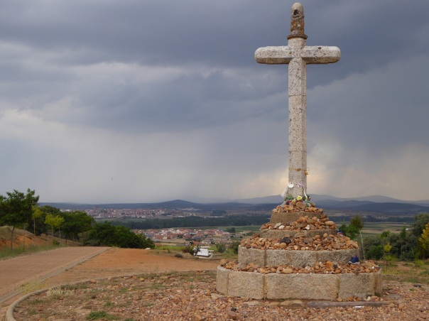 A typical Camino monument, this one just six long and wet km from our destination.  Note all the stones carefully placed at the bottom. - many picked up days before and left with the thoughts and prayers of the pilgram's.
