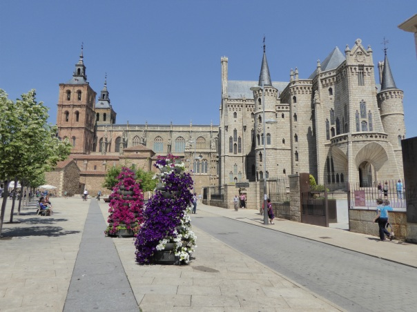 This shows the Cathedral on the left with Gaudi' building on the right. Look closely and you will see terraced planters with flowers in the foreground. We expect that you will see those again.... We love the idea and will try to copy the planter idea.