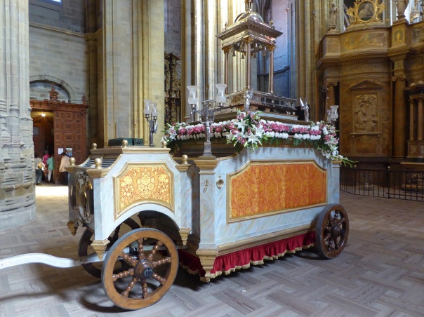 Covered in beautifully arranged fresh flowers, we caught this Corpus Christi parade entrant in the Cathedral.