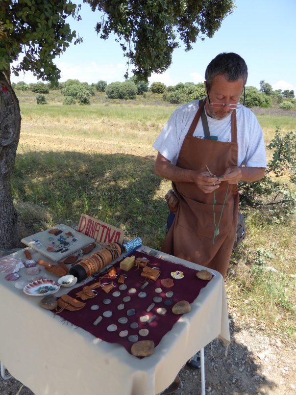 Camino capitalism at work. Here an artist has set up a table, miles from anywhere, and is selling his Camino inspired hand made items.  Others set up a snack and drink stand, again strategically placed, just where a thirsty pilgram' really needs a break. But the Camino lesson: everything we have seen being sold on the Camino, is either by donation or at prices well below the already low Spanish prices.